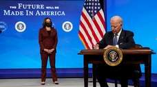 President Joe Biden signs an order closing loopholes