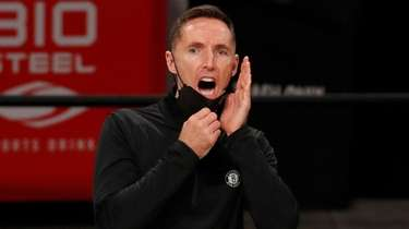 Head coach Steve Nash of the Nets reacts