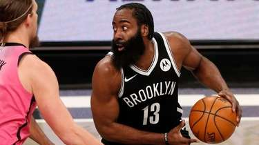 James Harden #13 of the Nets controls the