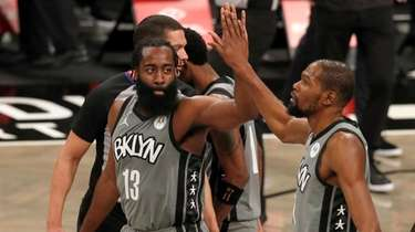 James Harden #13 and Kevin Durant #7 of