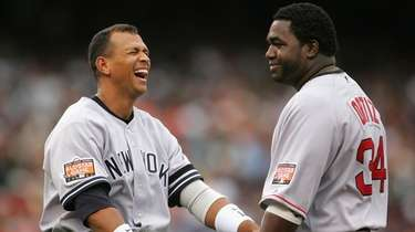 Alex Rodriguez of the Yankees laughs with David