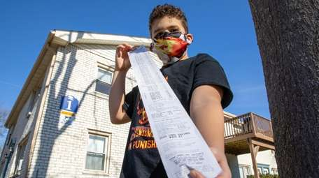 Gavin Connell, 12, shows his savings receipt from