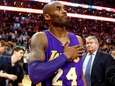 The Lakers' Kobe Bryant touches his chest as
