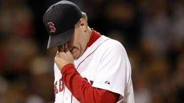 Red Sox pitcher Curt Schilling walks off the