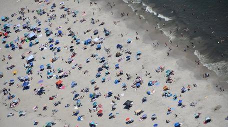 Crowds surge onto the sand at Jones Beach