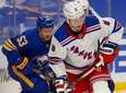 Rangers defenseman Jacob Trouba carries the puck during