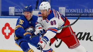 Rangers forward Pavel Buchnevich carries the puck past