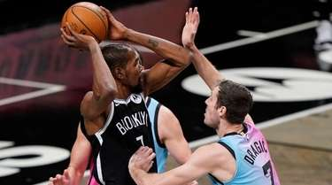 Brooklyn Nets' Kevin Durant passes the ball away