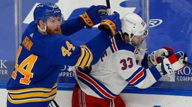 Sabres defenseman Matt Irwin checks Rangers forward Phillip