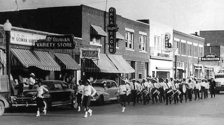 A band marches on Greenwood Avenue in Tulsa,