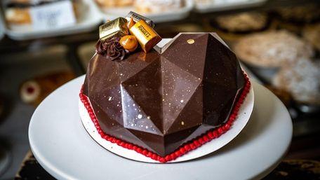 A breakable chocolate heart cake at Amanda's Bakery