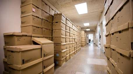 Exemption records are stacked at the Nassau County