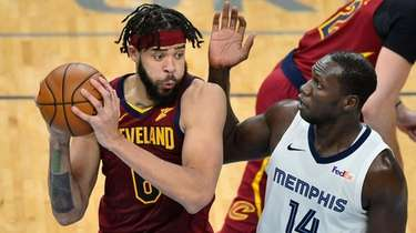 Cavaliers center JaVale McGee handles the ball against