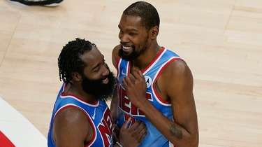 Nets guard James Harden, left, and forward Kevin
