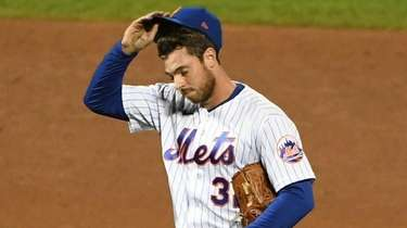 Mets pitcher Steven Matz reacts after giving up