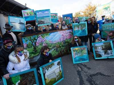 Artists and volunteers from Splashes of Hope deliver