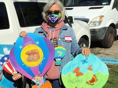 Grace Barrett holds artwork created from Grab &