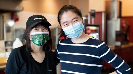 Jane Wu, left, owner of Wayback Burgers in