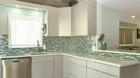 The kitchen has quartz countertops
