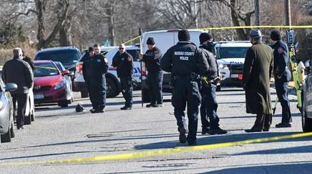 Nassau homicide detectives on Saturday in Uniondale investigate