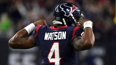 Texans quarterback Deshaun Watson celebrates after throwing a