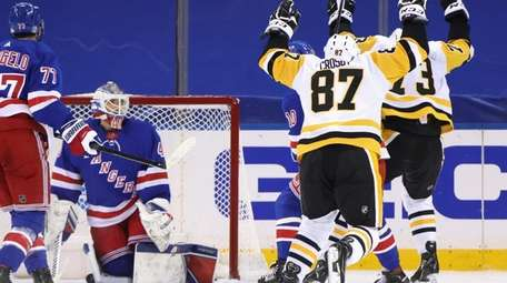Sidney Crosby of the Penguins celebrates his game-winning