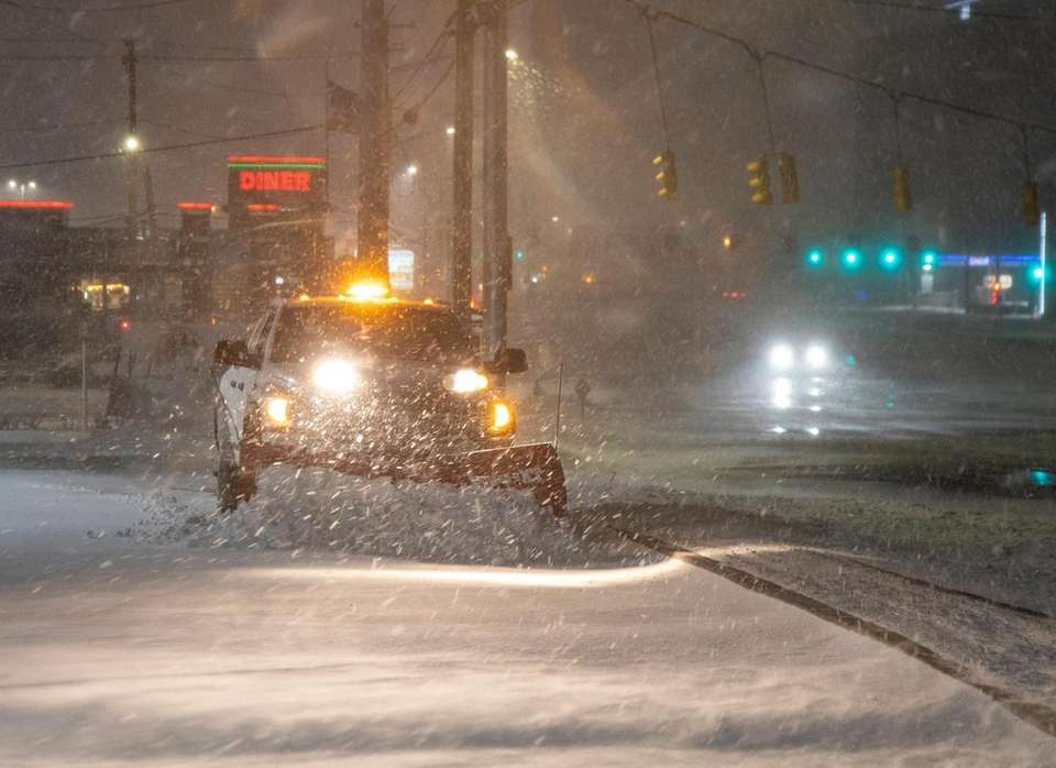 A plow clears a lot in the Country