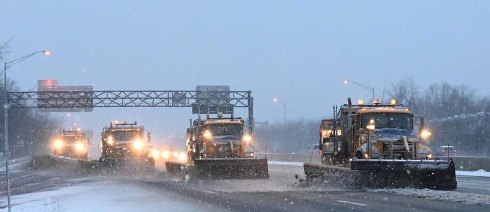 Plows clear snow along the eastbound LIE between