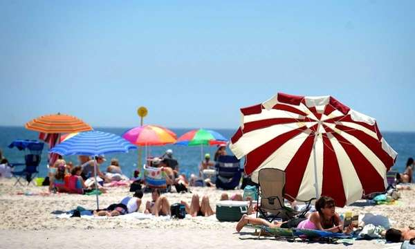 Umbrellas line the beach at Jones Beach. Check