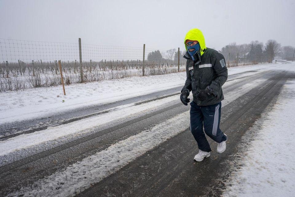 Gary Mlong, 67, of Mattituck jogs along Oregon
