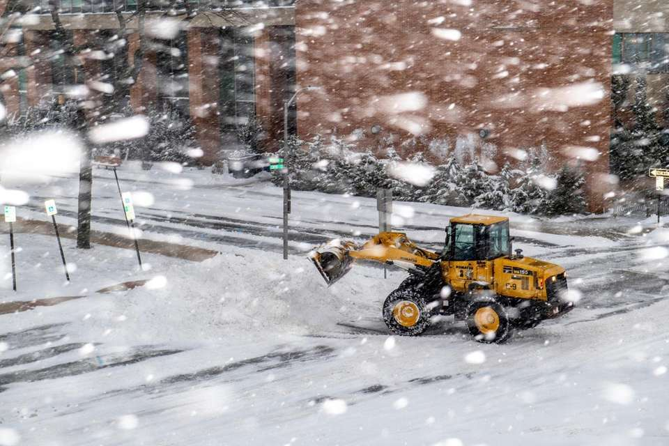 Snow is removed during a major snowstorm in