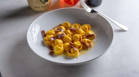 Cappelletti pasta with truffle ricotta filling, butter and
