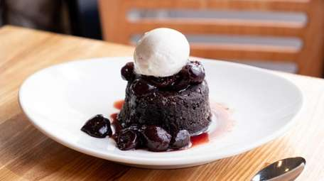 Warm chocolate cake with cherry balsamic sauce and