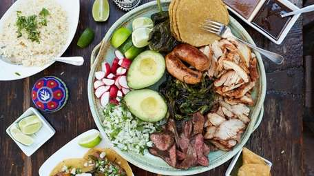 The Oaxaca market platter with grilled skirt steak,