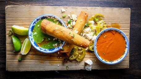 Duck confit and kimchi taquitos at Almond in