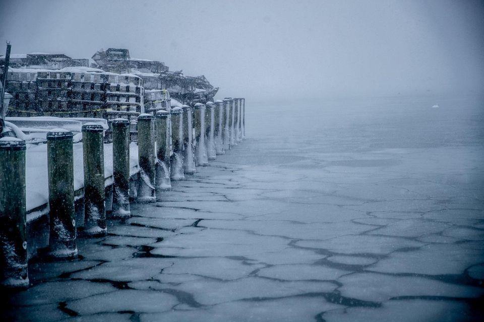 Northport harbor still seeing heavy snow falling through