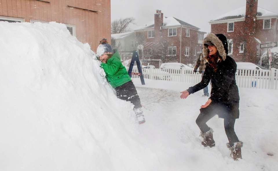 Tanner Cyriax, 3, slides down a large snow