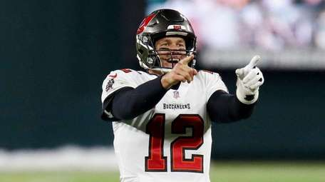 Tampa Bay Buccaneers quarterback Tom Brady reacts after