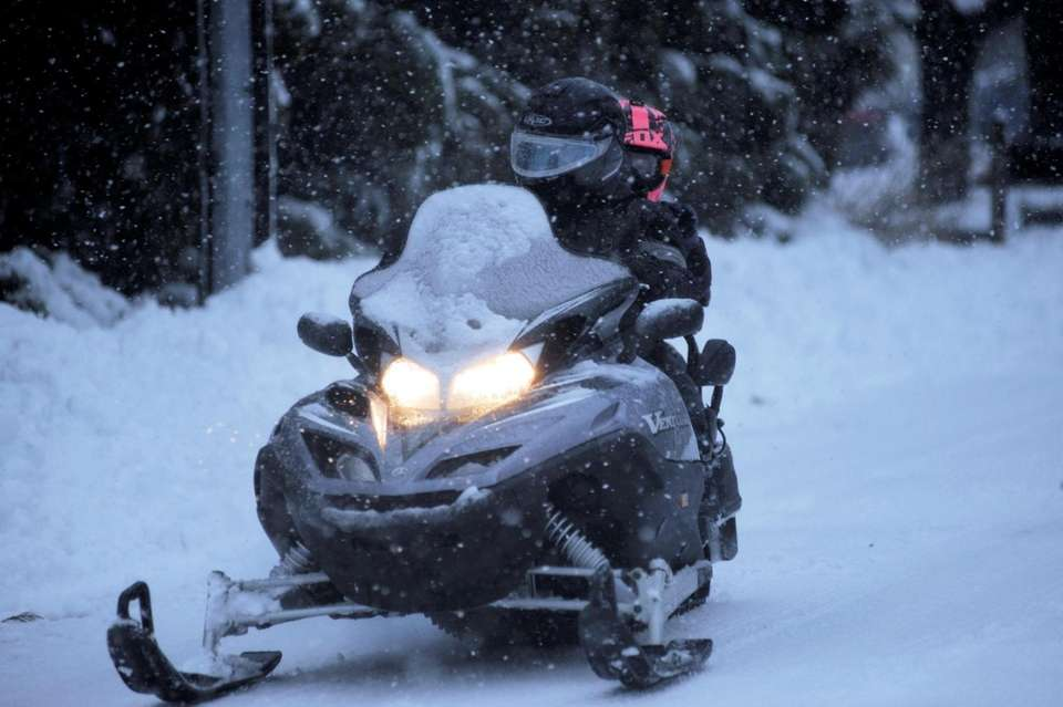 Snowmobiling on Belleview Road in Center Moriches on