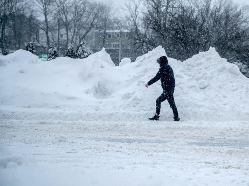 Kenneth Wei of Bay Shore walks to work