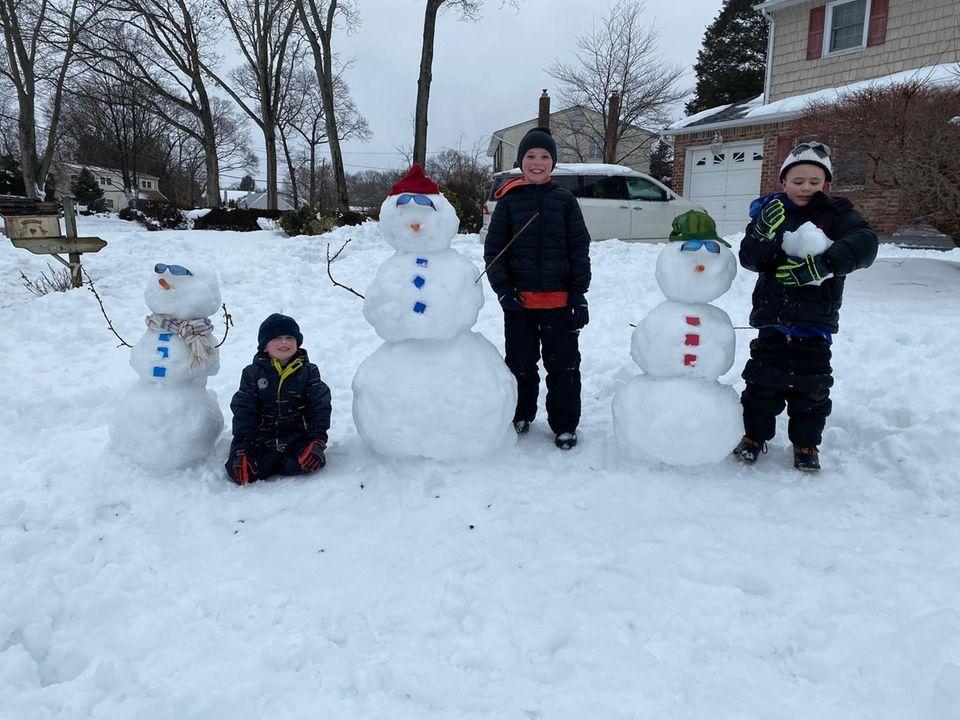 Holtsville! The Frank boys building snowmen!