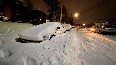Snow covered cars on 17th Street in Hicksville