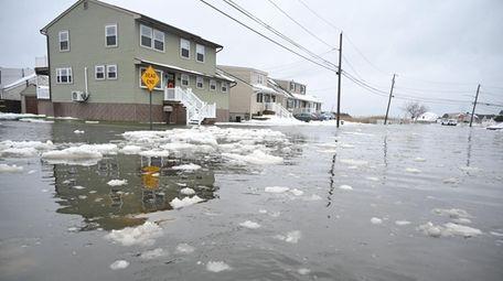 Flooding along Venetian Boulevard in Lindenhurst on Tuesday.
