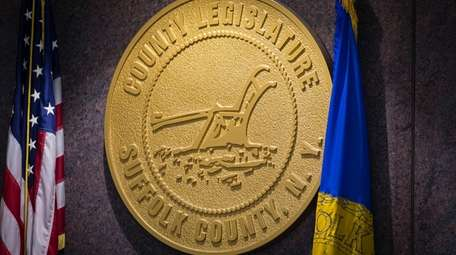 The Suffolk County Legislature medallion hangs on the