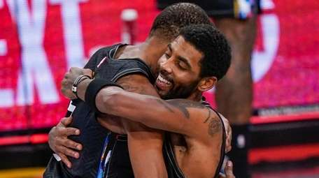 Nets forward Kevin Durant and Nets guard Kyrie