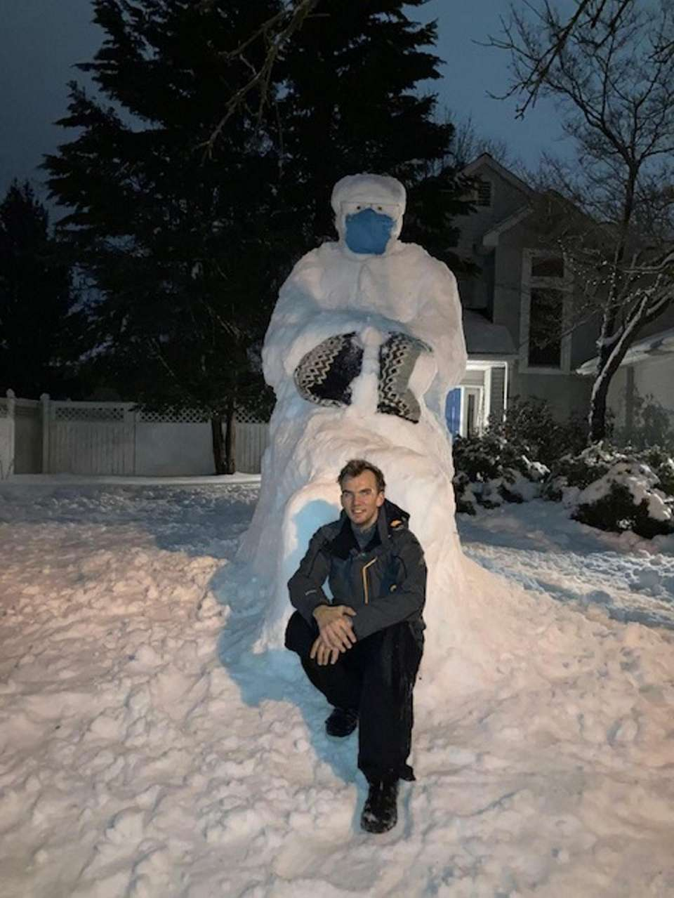 Me, posing in front of the snow sculpture.