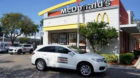 A caravan of fast food workers circle a
