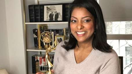 WNYW/5 reporter Lori Stokes poses with an Emmy