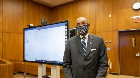 Nassau County Administrative Judge Norman St. George gives