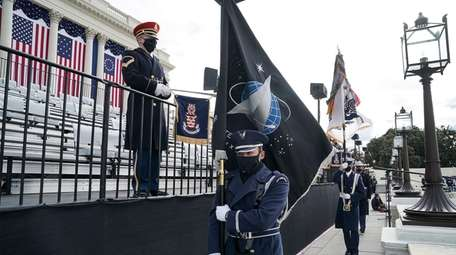 An honor guard member holds a Space Force